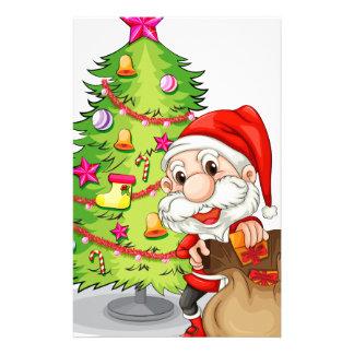 Santa Claus near the christmas tree Stationery