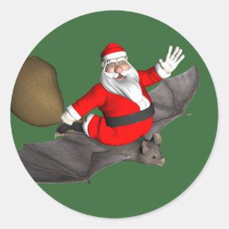 Santa Claus On Flying Bat Classic Round Sticker
