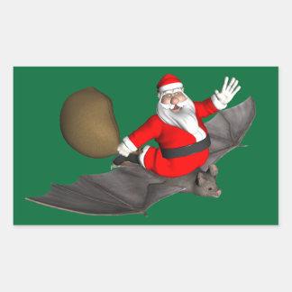 Santa Claus On Flying Bat Rectangular Sticker