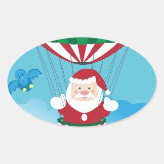Santa Claus on hot air balloon Oval Sticker