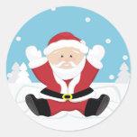 Santa Claus playing on snow. Round Stickers