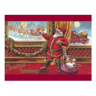 Santa Claus Points Proudly at His Portrait Postcard
