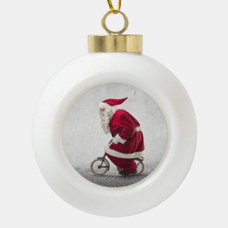 Santa Claus Rides A Bicycle Ceramic Ball Christmas Ornament