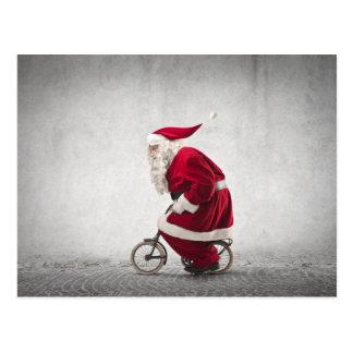 Santa Claus Rides A Bicycle Postcard