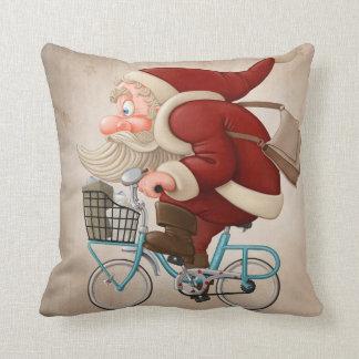 Santa Claus rides the bicycle Throw Pillows