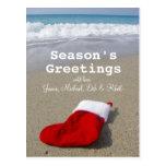 Santa Claus sock laying on beautiful beach Postcard
