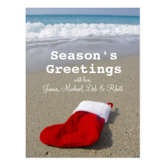 Santa Claus sock laying on beautiful beach Postcard