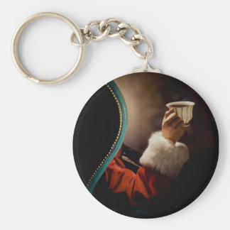 Santa Claus taking a break on Christmas Eve Keychain