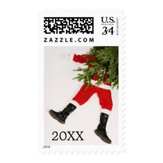 Santa Claus underneath Christmas tree Postage