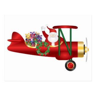 Santa Claus Waving on Biplane with Gifts Postcard