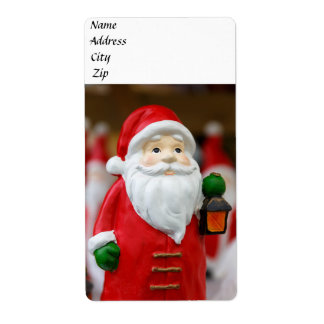 Santa Claus with a lantern Christmas decoration Label