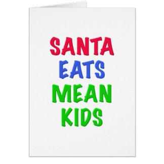 Santa come a niños malos tarjeta de felicitación