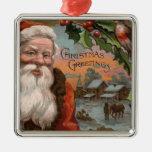 Santa con el acebo, escena del pueblo adorno cuadrado plateado