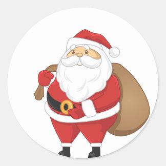 Santa con el bolso de presentes pegatina redonda