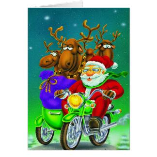 Santa con el reno en la bici tarjeta de felicitación