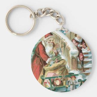 Santa con el trineo y presentes para los niños llavero redondo tipo pin