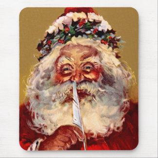Santa con la pluma alfombrillas de raton