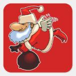 Santa con las alas y el bolso del juguete colcomanias cuadradas
