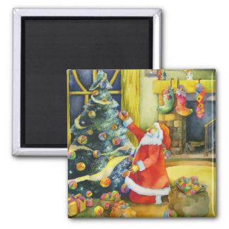 Santa con las bolas del hilado: Imán del navidad