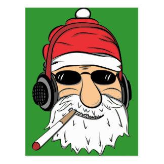 Santa con las gafas de sol cigarrillo y auriculare postal