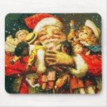 Santa con las muñecas tapetes de raton