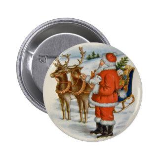 Santa con su reno pin redondo de 2 pulgadas