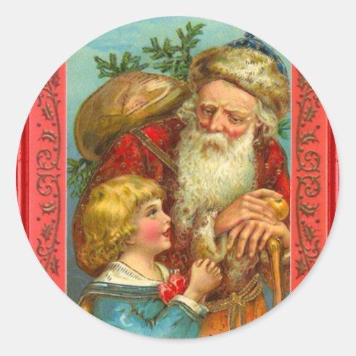 Santa con un chica en su rodilla etiqueta redonda