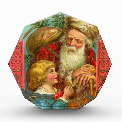 Santa con un chica en su rodilla