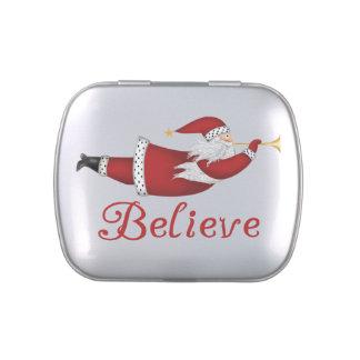 Santa cree las latas y sacude el caramelo del W. Latas De Caramelos