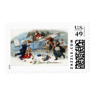 Santa Delivering Gifts Via Biplane Postage Stamp