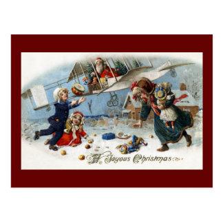 Santa Delivering Gifts Via Biplane Postcard