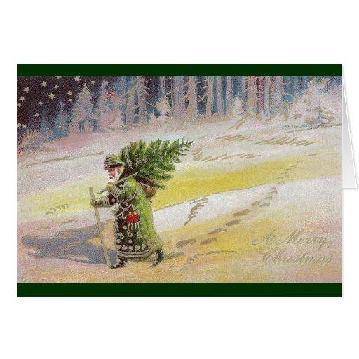 Santa en capa verde debajo del cielo estrellado tarjeta
