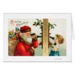 Santa en el teléfono con la niña tarjeta de felicitación