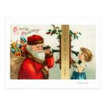 Santa en el teléfono con la niña tarjeta postal