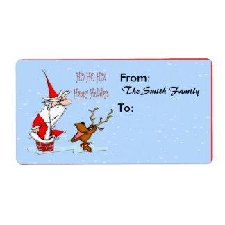 Santa en etiqueta de envío de la chimenea