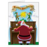 Santa en la tarjeta del día de fiesta del piano