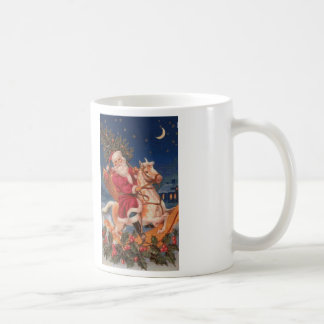 Santa en la taza de café de la puntada de la cruz