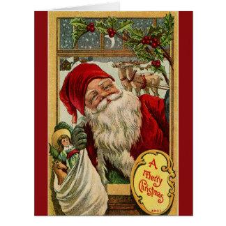 Santa en la ventana con la tarjeta de felicitación