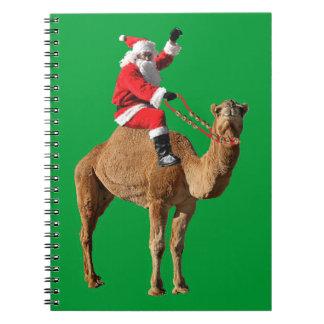 Santa en navidad del camello libros de apuntes