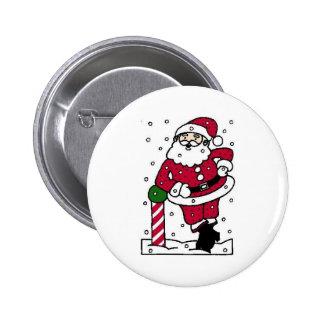 Santa en nieve pin redondo de 2 pulgadas