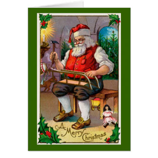 Santa en su taller tarjeta de felicitación