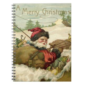 Santa en su trineo note book