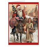 Santa en tarjeta de Navidad del vintage del burro