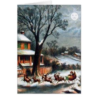 Santa en trineo con el reno tarjetón