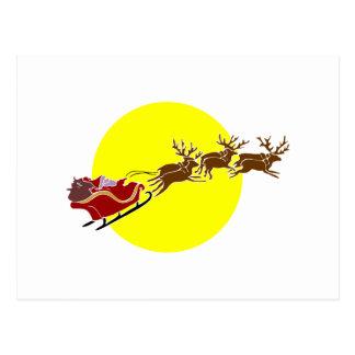Santa en trineo postal
