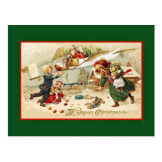Santa en un aeroplano tarjeta postal