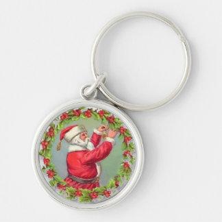 Santa en una guirnalda llavero redondo plateado