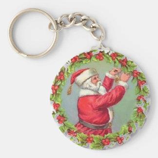 Santa en una guirnalda llavero redondo tipo pin