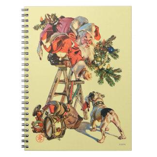 Santa encima de una escalera libro de apuntes con espiral