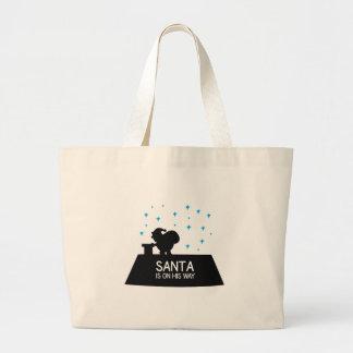 Santa está en su manera bolsa tela grande